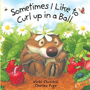 Sometimes I like to curl up in a Ball, written and illustrated by Vicki Churchill and Charles Fuge. A wombat is sitting curled up in the middle of a strawberry patch.