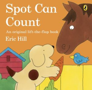 Spot Can Count written and illustrated by Eric Hill. A yellow puppy,with a brown spot on its side, feeds a carrot to a brown horse.