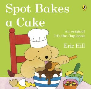 Spot Bakes a Cake written and illustrated by Eric Hill. A yellow puppy dog, wearing a chef's hat, sits at the kitchen table licking the brown cake mixture off a wooden spoon over a mixing bowl.