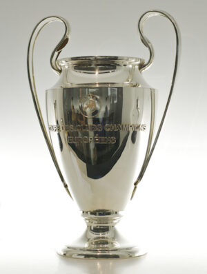 Photograph of silver, vase trophy with large handles and enscribed with UEFA emblem.