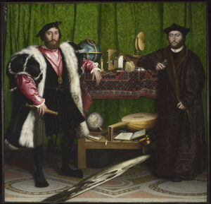 Portrait of two grandiose noblemen leaning against a display table containing an eclectic mix of objects.