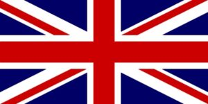 Union Jack Flag. Red, white a blue combination of thick bands, thin lines, blue traingles. A red vertical and horizontal with red diagonals, corner to corner, set against a blue and white background.