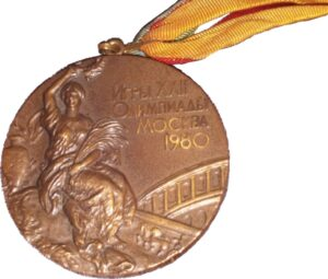 Bronze Olympic medal depicting Greek godess beside the Colosseum.