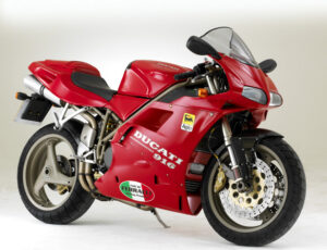 Photograph of a red 1198 Ducati superbike.