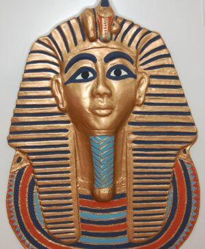 Tutankahmun's Mask, embellished gold mask of this ancient Egyptian pharaoh.
