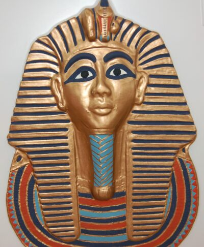 Tutankahmun's Mask, embellished gold mask of this ancient Egyptian pharaoh.
