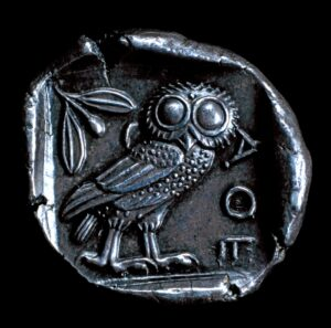 Silver Athenian Coin with Owl detail