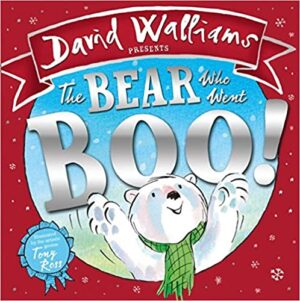 he Bear who went Boo! Written by David Walliams and illustrated by Tony Ross. A very smily polar bear, wearing a green check scarf,  in the centre of an icy scenery.