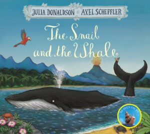 The Snail and the Whale, written and illustrated by Julia Donaldson and Axel Scheffler, A large whale swimmming around in the shores of the sea and a tiny snail is taking a ride on his tail. A volcano is erupting in the background.