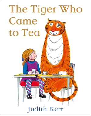 The Tiger who came to Tea, written and illustrated by Judith Kerr. A little girl is sitting at table having a cup of tea with a large smiley tiger.