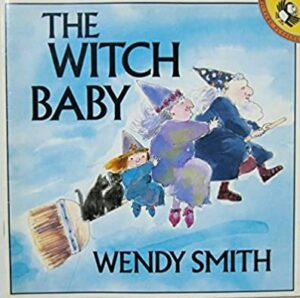 The Witch Baby, written and illustrated by Wendy Smith. A wizard, a witch and a witch baby flying on a broomstick with two little black cats.