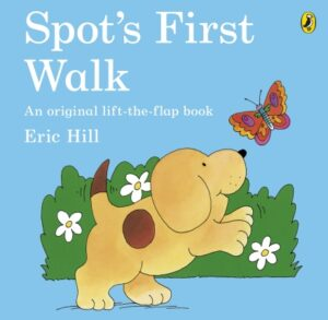 Spot's First Walk written and illustrated by Eric Hill. A yellow puppy with a brown spot on its side walks along wth two front legs raised in the air, looking happy to see a colouful butterfly.