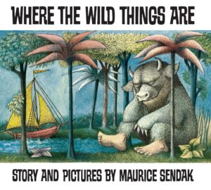 Where the Wild Things Are. Story and pictures by Maurice Sendak. A wild grey beast asleep under some strange looking palm trees. A yellow yacht is anchored in a lake behind him.
