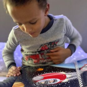 Jai reading Touch to See book Goodnight Spaceman