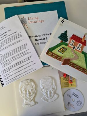 Tactile pictures of a house, and facial expressions plus an A4 pamphlet.