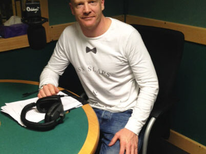 Iwan Thomas in Studio wearing headphones and smiling