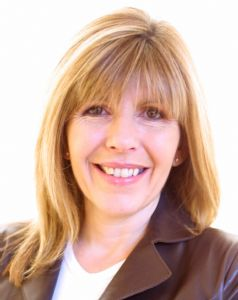 Head and shoulders photo of Maggie Philbin, smiling.