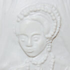 Close-up of tactile of Queen Elizabeth I with an embellished headband and necklace