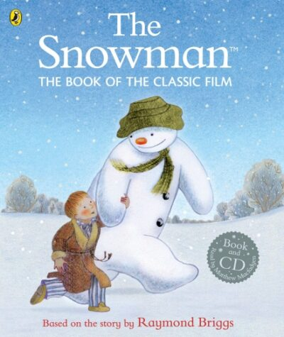The Snowman. The book of the classic film based on the story by Raymond Briggs. Picture shows The Snowman walking hand in hand with a little boy and snow falling all around them.