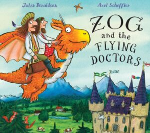 Zog and The Flying Doctors, written by Julia Donaldson and Illustrated by Axel Scheffler. Zog flying over a castle with 2 doctors on his back.