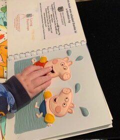 A child feeling Peppa Pig