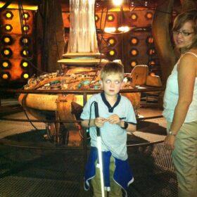 Louis inside the Tardis as a little boy