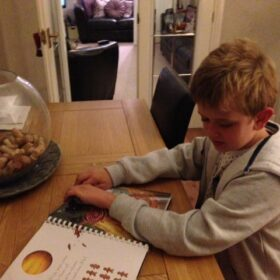 A boy reading the braille in Star Seeker