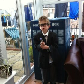 Louis as a little boy, dressed as Doctor Who
