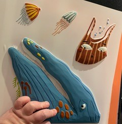 A child's hand feeling Somebody Swallowed Stanley