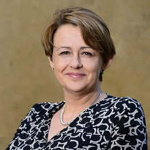 Head and shoulders shot of a smiling Tanni.